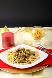Pasta with sardines and fennel on Christmas table Royalty Free Stock Photos