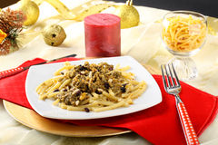 Pasta with sardines and fennel on Christmas table Stock Images