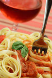 Pasta With Sauce and A Basil Leaf Stock Image