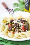Pasta with sauce chicken hearts, vegetables, red paprica, green Stock Photo
