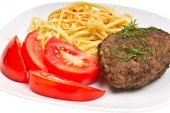 Pasta with sauce, cutlet and tomato Stock Image