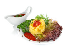 Pasta with sauce and greenery Royalty Free Stock Photos
