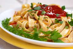 Pasta with sauce and greens. Royalty Free Stock Photography