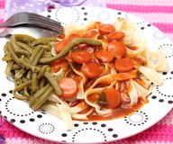 Pasta with a sauce of sausages. Some fresh pasta with a sauce of sausages Stock Photography