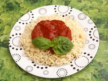 Pasta with a sauce of tomatoes Stock Photos