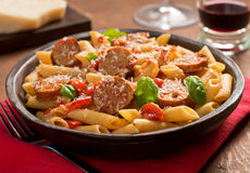 Pasta with Sausage. Cajun style pasta with penne, spicy sausage, red peppers, and tomato sauce with freshly grated parmesan cheese Royalty Free Stock Photos