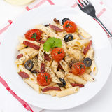 Pasta with sausage, cherry tomatoes and olives, close-up Royalty Free Stock Photos