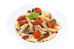 Pasta with sausage, cherry tomatoes and olives, isolated Stock Photography