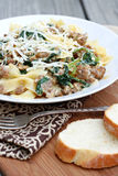 Pasta with Sausage and Greens. Bowtie pasta with sausage and greens royalty free stock image