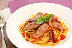 Pasta with sausage and tomato Stock Images