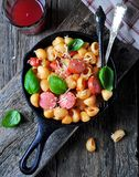 Pasta with sausages in tomato sauce with basil and cheese Royalty Free Stock Photos