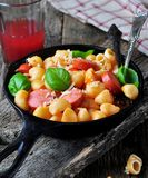 Pasta with sausages in tomato sauce with basil and cheese Royalty Free Stock Images