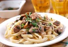 Pasta with sauteed mushrooms Royalty Free Stock Image