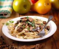 Pasta with sauteed mushrooms Stock Photo