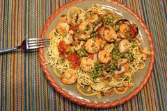Pasta with savory seafood sauce. Noodles covered with delicious seafood sauce ready for eating royalty free stock photo