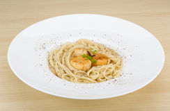 Pasta with scallops. And fresh green herbs royalty free stock photography