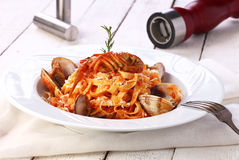 Pasta with sea products on a white background Stock Photo