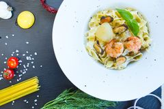 Pasta with seafood on a black stone table. Top view Stock Photography