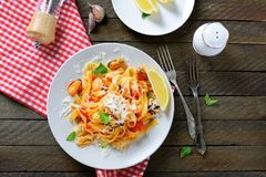 Pasta with seafood and cheese Stock Photo