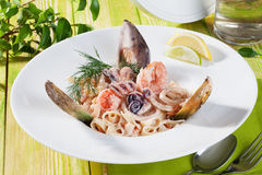 Pasta with seafood dish beautiful Italian food in Royalty Free Stock Photos