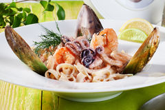 Pasta with seafood dish beautiful Italian food in still life shrimp shell mussel octopus dill Royalty Free Stock Image