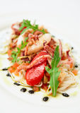 Pasta with seafood on oval porcelain plate Stock Photo