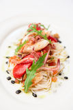 Pasta with seafood on oval porcelain plate Stock Image