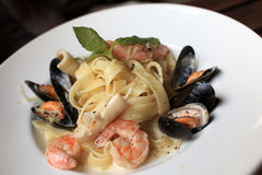 Pasta with seafood on plate Royalty Free Stock Image