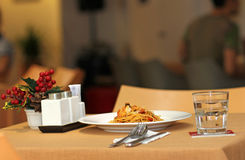 Pasta with Seafood and White Wine in Restaurant at Summer. Hotel terrace restaurant at summer stock photography
