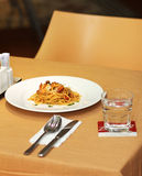 Pasta with Seafood and White Wine in Restaurant at Summer. Hotel terrace restaurant at summer Royalty Free Stock Photos