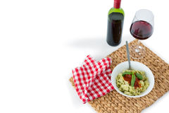 Pasta served in bowl on place mat with wine and napkin Royalty Free Stock Photo