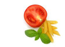 Pasta Setting II. Pasta, basil and tomato on white background Stock Images