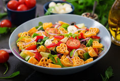 Pasta in the shape heart salad with tomatoes, cucumbers, olives, mozzarella and red onion Royalty Free Stock Images