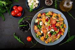 Pasta in the shape heart salad with tomatoes, cucumbers, olives, mozzarella and red onion Stock Photos