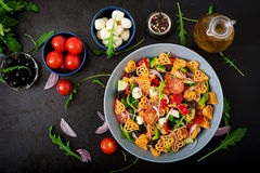 Pasta in the shape heart salad with tomatoes, cucumbers, olives, mozzarella and red onion Stock Images