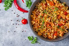 Pasta in the shape of hearts with chicken and tomatoes in tomato sauce. Top view Royalty Free Stock Image