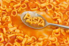 Pasta shaped letters spelling the word PASTA in tomato sauce on Stock Photo