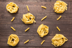 Pasta shapes collection on a wooden background Stock Photos