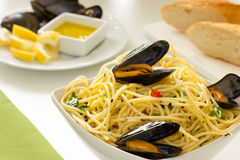 Pasta with shellfish. Lemon and bread Royalty Free Stock Photography