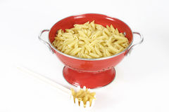 Pasta shells in colander Stock Images