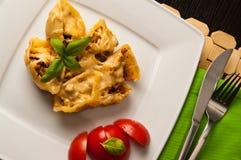 Pasta shells conchiglioni stuffed with meat Stock Photo
