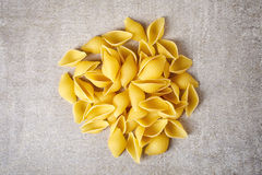 Pasta shells on stone table, from above Stock Images