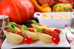 Pasta shells stuffed with minced meat , pumpkin and zucchini Stock Image