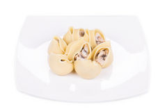 Pasta shells on stuffed with mushrooms. Royalty Free Stock Images