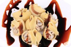 Pasta shells stuffed with mushrooms on a plate. Stock Images