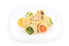 Pasta shells stuffed with vegetables on a plate. Stock Photo