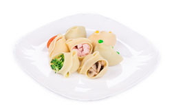 Pasta shells stuffed with vegetables and sausage. Royalty Free Stock Image
