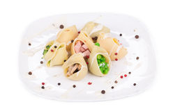 Pasta shells stuffed with vegetables and sausage. Stock Image
