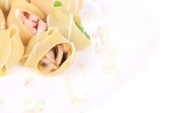 Pasta shells stuffed with vegetables and sausage Stock Photos