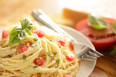Pasta shot with ingredients. Meatless pasta with fresh tomatoes and basil Stock Image